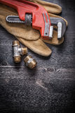 Monkey wrench copper pipe fittings leather working Royalty Free Stock Photography