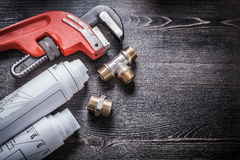Monkey wrench copper plumbing fittings rolled up Stock Images