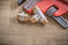 Monkey wrench pipe fittings on mesh filter grid Stock Image