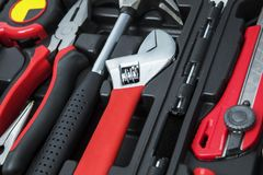 Monkey wrench and pliers in the box. Closeup of monkey wrench and pliers with tools in the toolbox royalty free stock photography