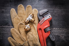 Monkey wrench plumbing fittings leather protective Royalty Free Stock Images