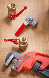 Monkey wrench and plumbing fixtures Stock Images