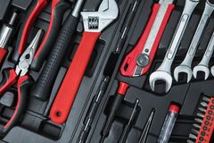 Monkey wrench with workshop tools. Top view of monkey wrench with with workshop tools in the toolbox royalty free stock photo