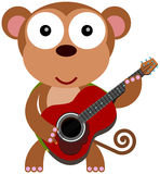 Monkeying with a guitar Royalty Free Stock Photos