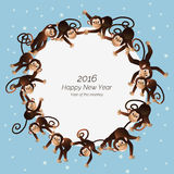 Monkeys in a circle. On a blue background depicts a white circle on the edge of which is shown, funny monkey, in the center of the white circle Happy New Year Royalty Free Stock Photos