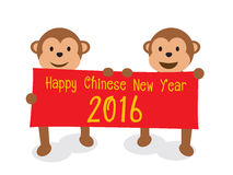 Monkeys holding board Happy Chinese New Year 2016 Royalty Free Stock Photos