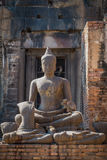 Monkeys. Relaxation of monkeys on the buddha statue in Thailand Stock Photography