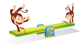 Monkeys on a seesaw. Monkeys planying on a seesaw Royalty Free Stock Photography