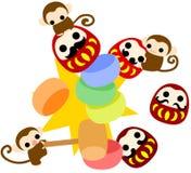 Monkeys and shooting tumbling doll Stock Photo