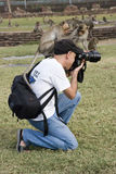 Monkeys Sit on Photographer Royalty Free Stock Photos
