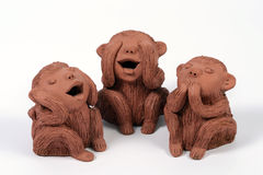 3 monkeys. Three monkeys, the three wise monkeys that see no evil, hear no evil and speak no evil stock photo