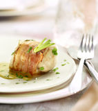 Monkfish fillet wraped in bacon Royalty Free Stock Image