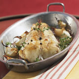 Monkfish with garlic Royalty Free Stock Images