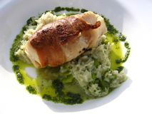 Monkfish Wrapped in Palma Ham on a Bed of Mint Risotto Royalty Free Stock Images