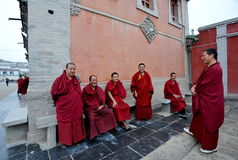 Monks. Tibetan monks discussing near the entrance to the monastery Stock Image