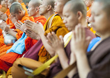 Monks at Alms Ceremony Stock Images