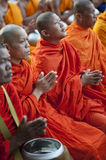 Monks at Alms Ceremony Stock Image