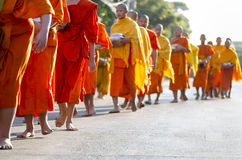 Monks at Alms Ceremony Stock Photo