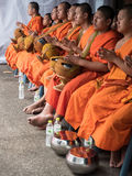 Monks Alms Ceremony, Thailand. CHIANG MAI, THAILAND - APRIL 13 2015: The official opening ceremony of Songkran (Thai New Year Festival). This is marked by the Stock Images