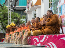 Monks Alms Ceremony, Thailand. CHIANG MAI, THAILAND - APRIL 13 2015: The official opening ceremony of Songkran (Thai New Year Festival). This is marked by the Royalty Free Stock Image