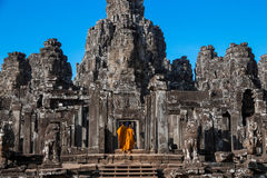 The monks in the ancient stone faces of Bayon temple, Cambodia Royalty Free Stock Photography