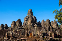 The monks in the ancient stone faces of Bayon temple, Cambodia Royalty Free Stock Image