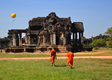 Monks at Angkor Wat. Despite so many other things to do in Siem Reap, the UNESCO World Heritage Site of Angkor Wat is still the primary draw for tourists Royalty Free Stock Image