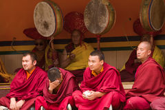 Monks as attentive spectators and ritual festival drummers. Lama stock photography