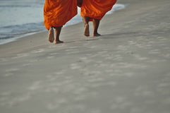 Monks on the beach stock image