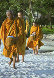 Monks on beach Royalty Free Stock Images