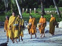Monks on beach Stock Photo