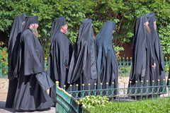 Monks in black Royalty Free Stock Photography