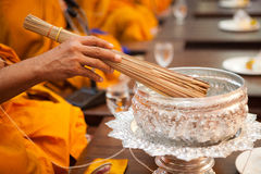 Monks, bowl with a candle and holy water. Buddhist monks, bowl with a candle and holy water insid Royalty Free Stock Photos
