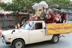 Monks on a car with speakers at Mandalay, Myanmar. Stock Photo