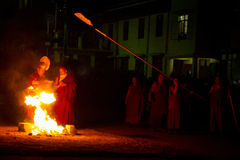 Monks and ceremonial fire Gyuto monastery, Dharamshala, India stock images