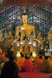 Monks chanting inside Viharn of Wat Phra That Doi Suthep. Stock Photos