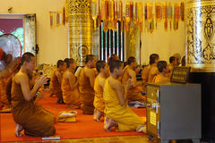 Monks in Chedi Luang temple Stock Images
