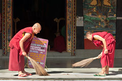 Monks cleaning monastery Royalty Free Stock Images