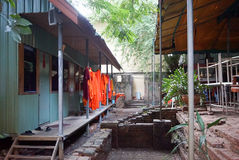 Monks clothes drying outside house Stock Image