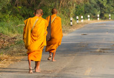 Monks collecting alms Royalty Free Stock Photos