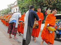 Monks collecting alms, Luang Prabang. Buddhist monks collecting alms early morning in Luang Prabang, Laos royalty free stock images
