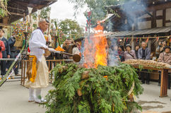 Monks conducting fire for ceremony at Kinkakuji Temple Royalty Free Stock Photography