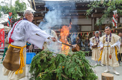 Monks conducting fire for ceremony at Kinkakuji Temple Royalty Free Stock Image