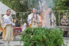 Monks conducting fire for ceremony at Kinkakuji Temple Royalty Free Stock Photos