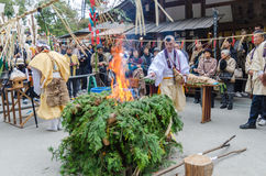 Monks conducting fire for ceremony at Kinkakuji Temple Stock Photo