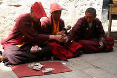 Monks counting money Royalty Free Stock Images