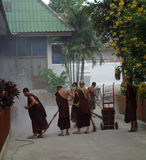 Monks  doing cleaning Royalty Free Stock Photos