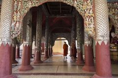 Monks dressed in robes visiting richly decorated Ananda temple in Bagan. Burmese monks dressed in robes visiting richly decorated 12th Century Ananda temple in Royalty Free Stock Photography