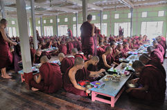 Monks Eating Lunch royalty free stock photo