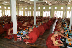 Monks eating at Mahagandayon Monastery in Mandalay, Myanmar Royalty Free Stock Photos